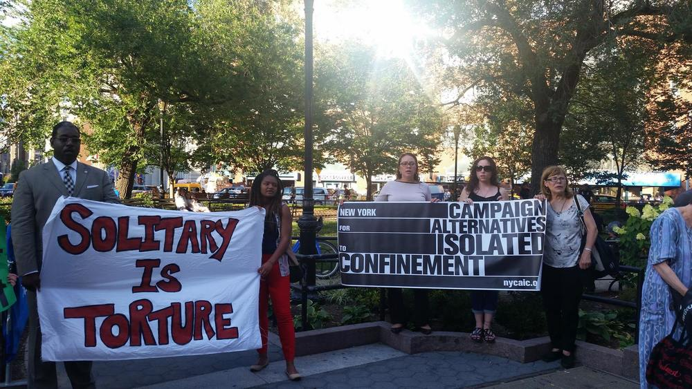 Activists with CAIC rally and speak out against solitary confinement.