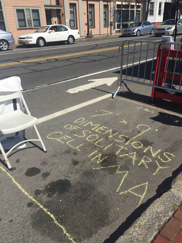 "Park(ing) Day 2015, from  Coalition for Effective Public Safety - CEPS  FB page: ""Some of the segregation cells in  #MA  are 7 feet by 9 feet. You can fit about 2 of them into a regular sized parking spot. Imagine being confined to less than a parking spot for a prolonged period of time. """