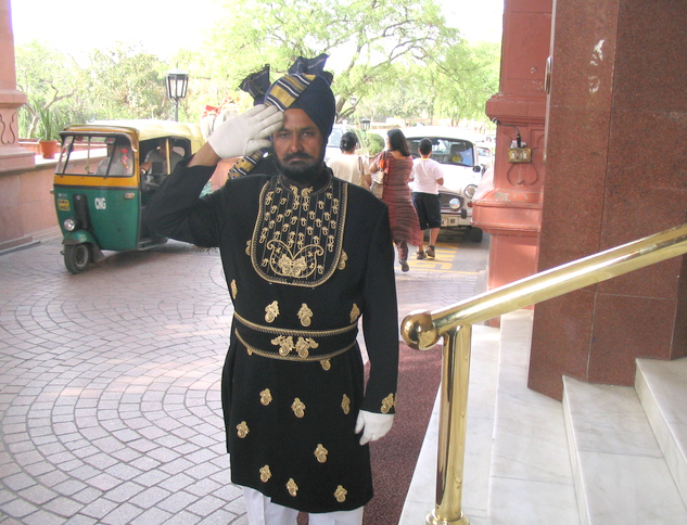 Doorman saluting at Taj Hotel in New Delhi