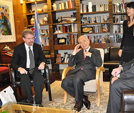 Jon Lapidese with Shimon Peres in his office.