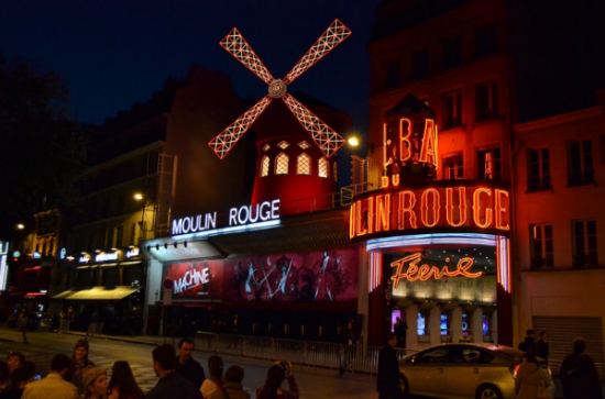 The nighttime lights of the Moulin Rouge
