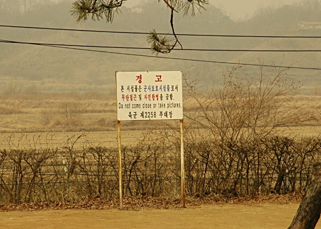 Along the DMZ - warning signs