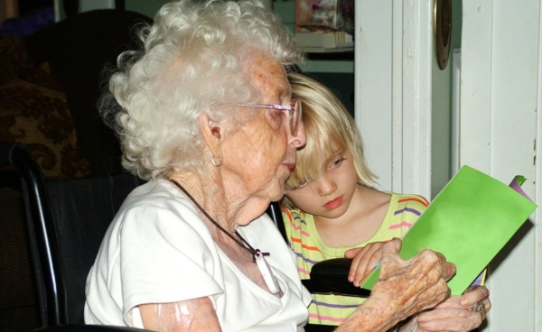 Sunny  child reading with grandmother.jpg
