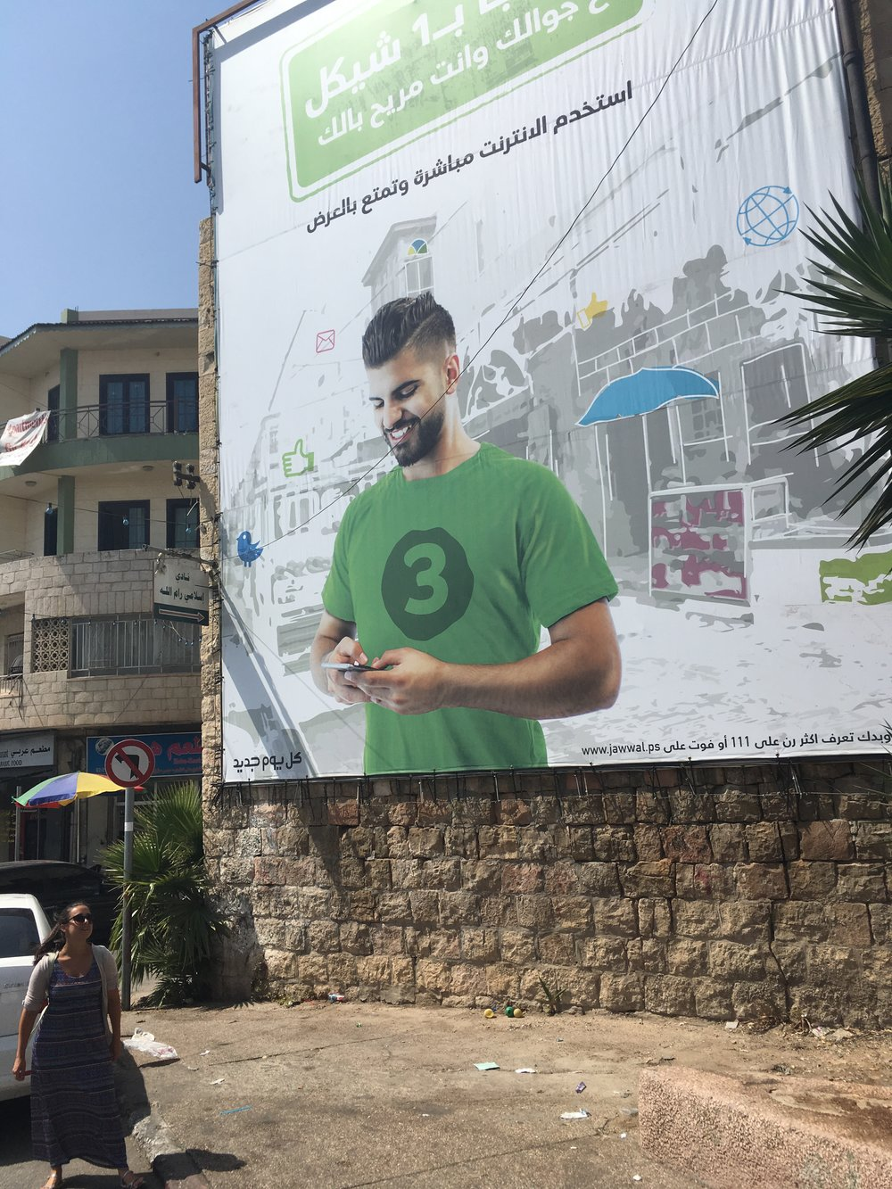 A king sized billboard.  It's for the mobile service provider, not the haircut.