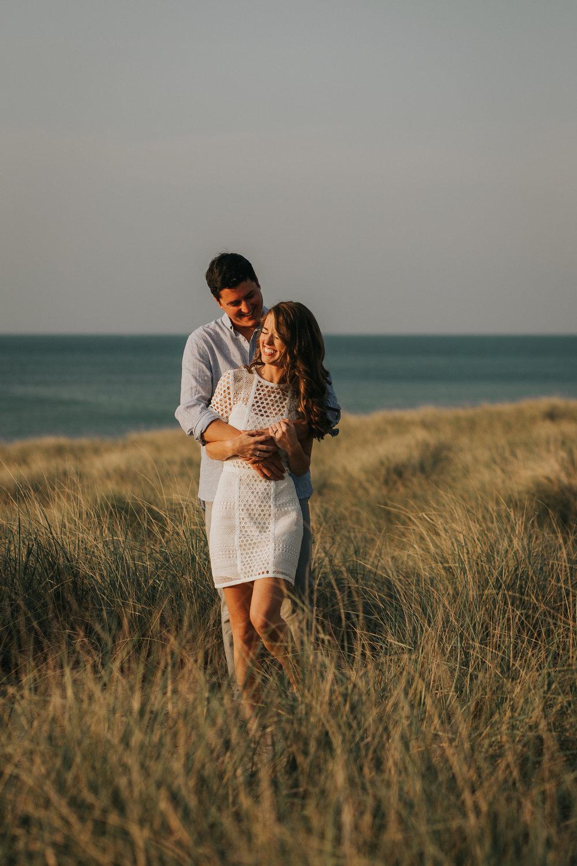 St. Joseph, MI engagement pictures at beach, white dress