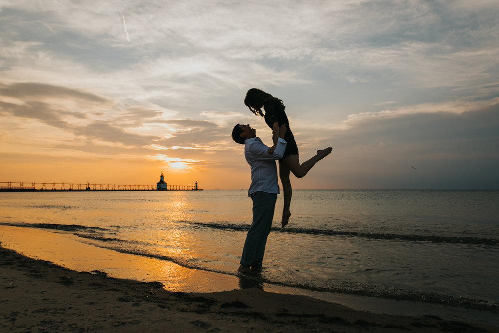 St. Joseph, MI engagement pictures, beach sunset silhouette, lighthouse, Lake Michigan