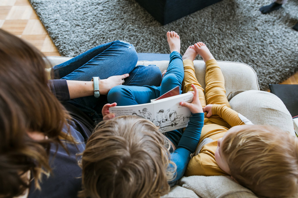 mom and boys reading book from above, family film session mishawaka