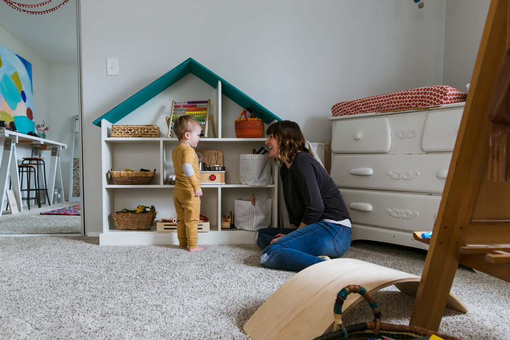 mom and toddler playing in playroom, family film session mishawaka