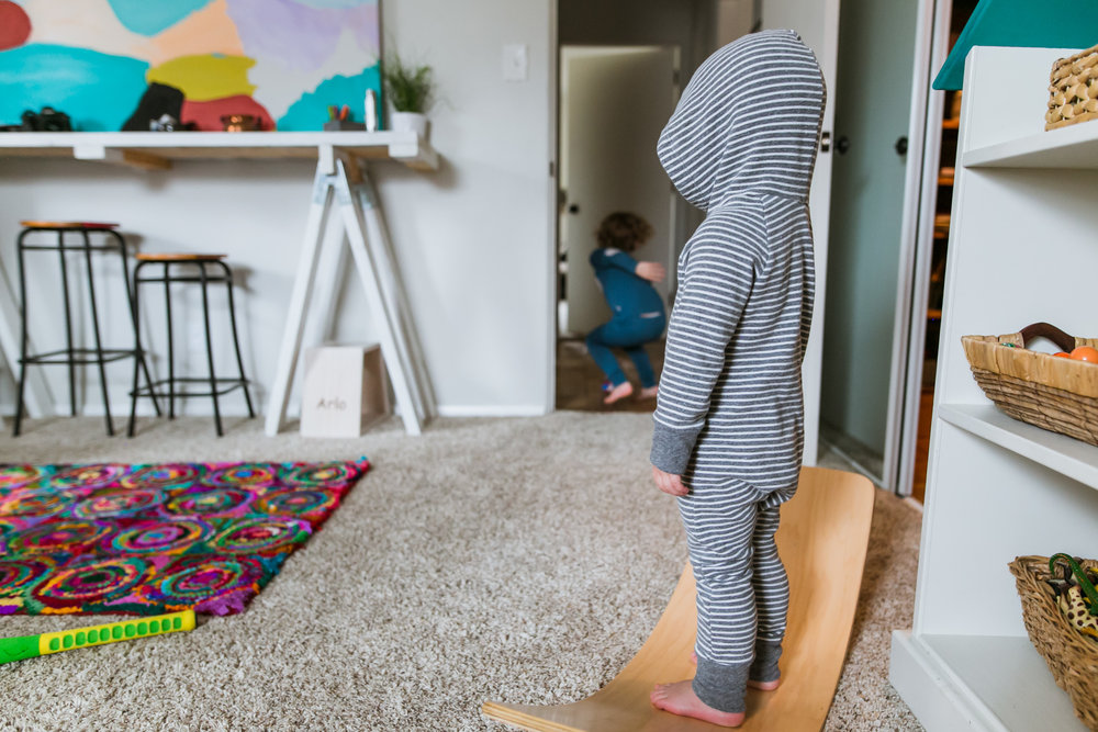 little brother watching, playroom, grey hoodie, family film session mishawaka