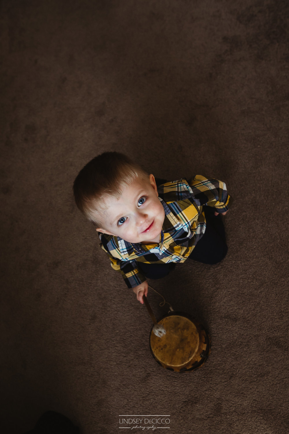 Older brother playing with his drum