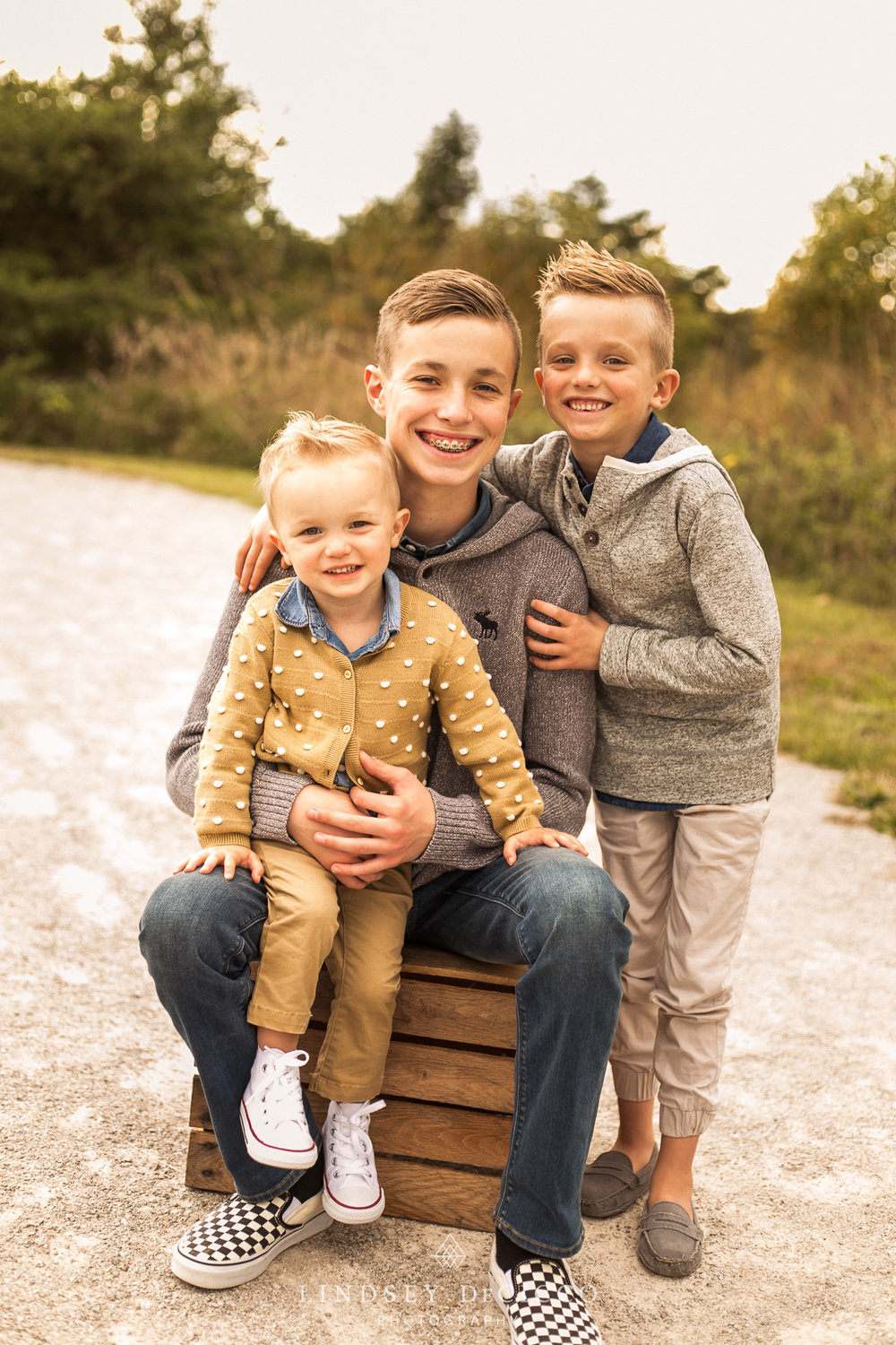 three boys family picture pose