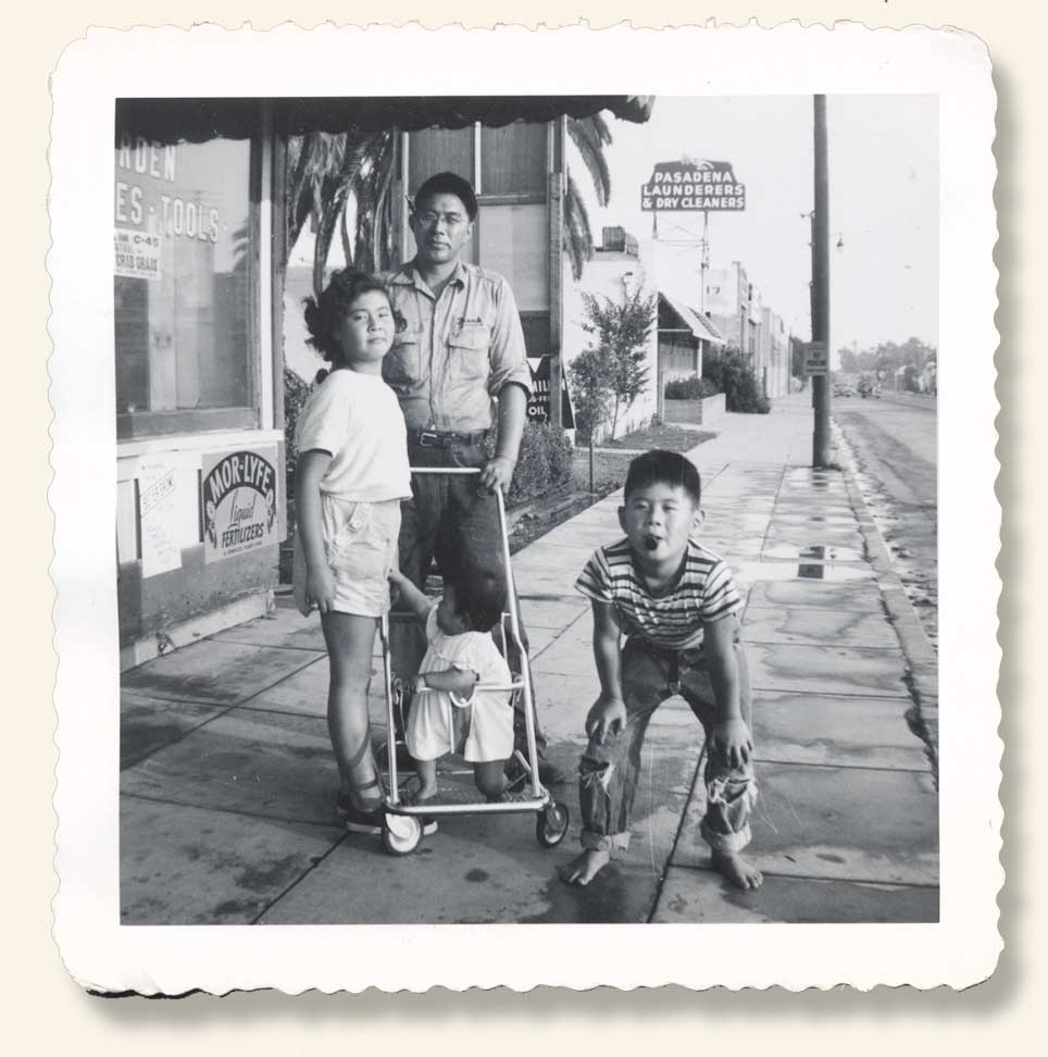 Storefront and Uncle Frank posing with his kids Betty, David, and Sharon. 1953. (Click to enlarge.)