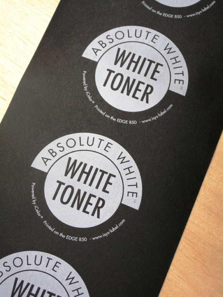 absolute white toner printed on black textured label stock