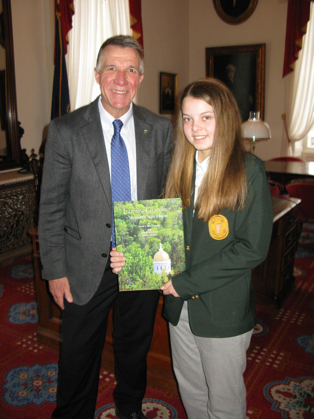 Governor Scott with Sabina and her copy Intimate Grandeur, the State House history.