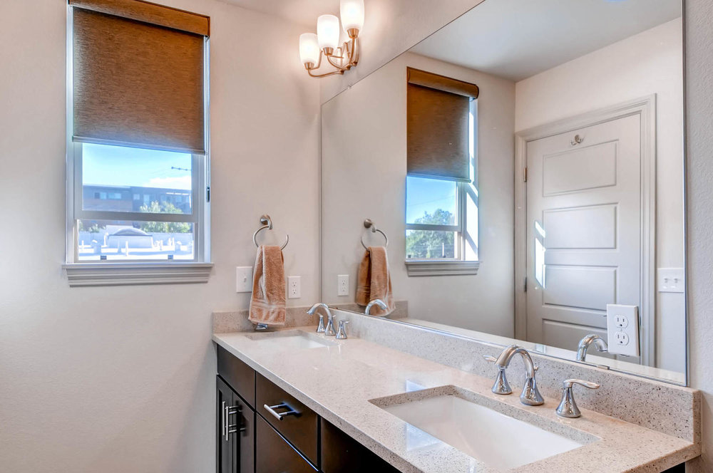 Master Bath is an oasis. Large Double Quartz vanity, walk in shower