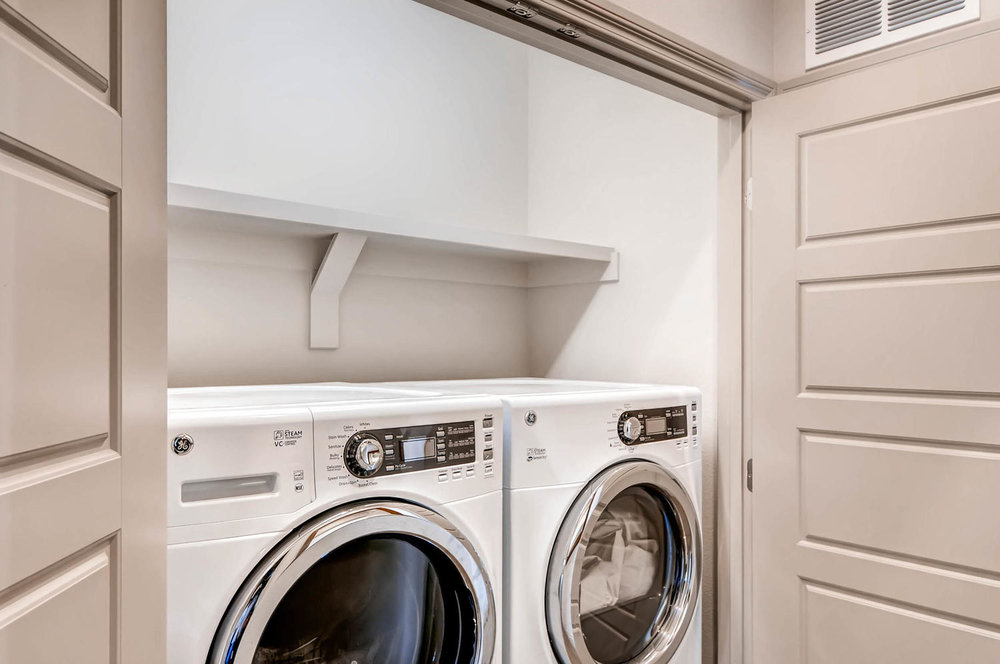 Nearly new side by side washer and dryer in dedicated laundry closet, ample additional linen storage