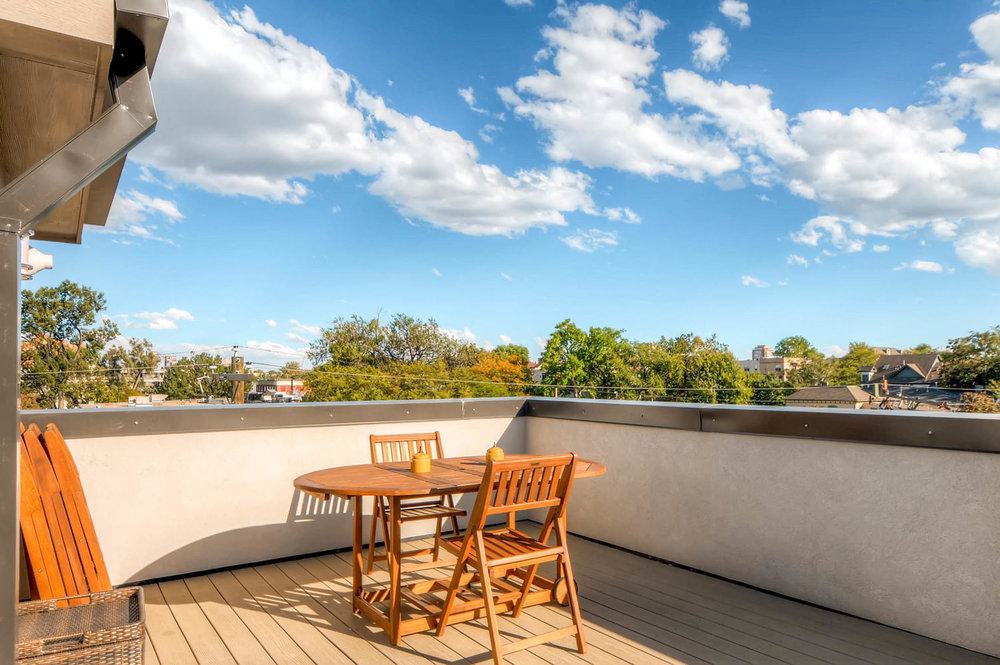 Massive Private Rooftop deck can accommodate multiple seating areas