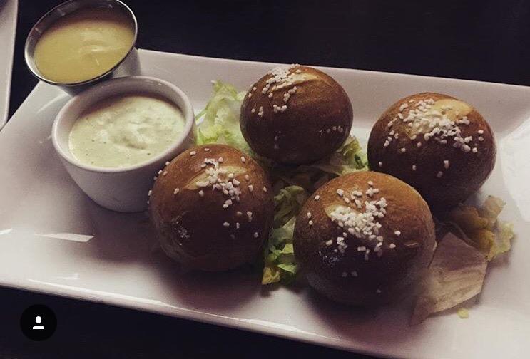 4 Stuffed Pretzel Balls with a side sauce.