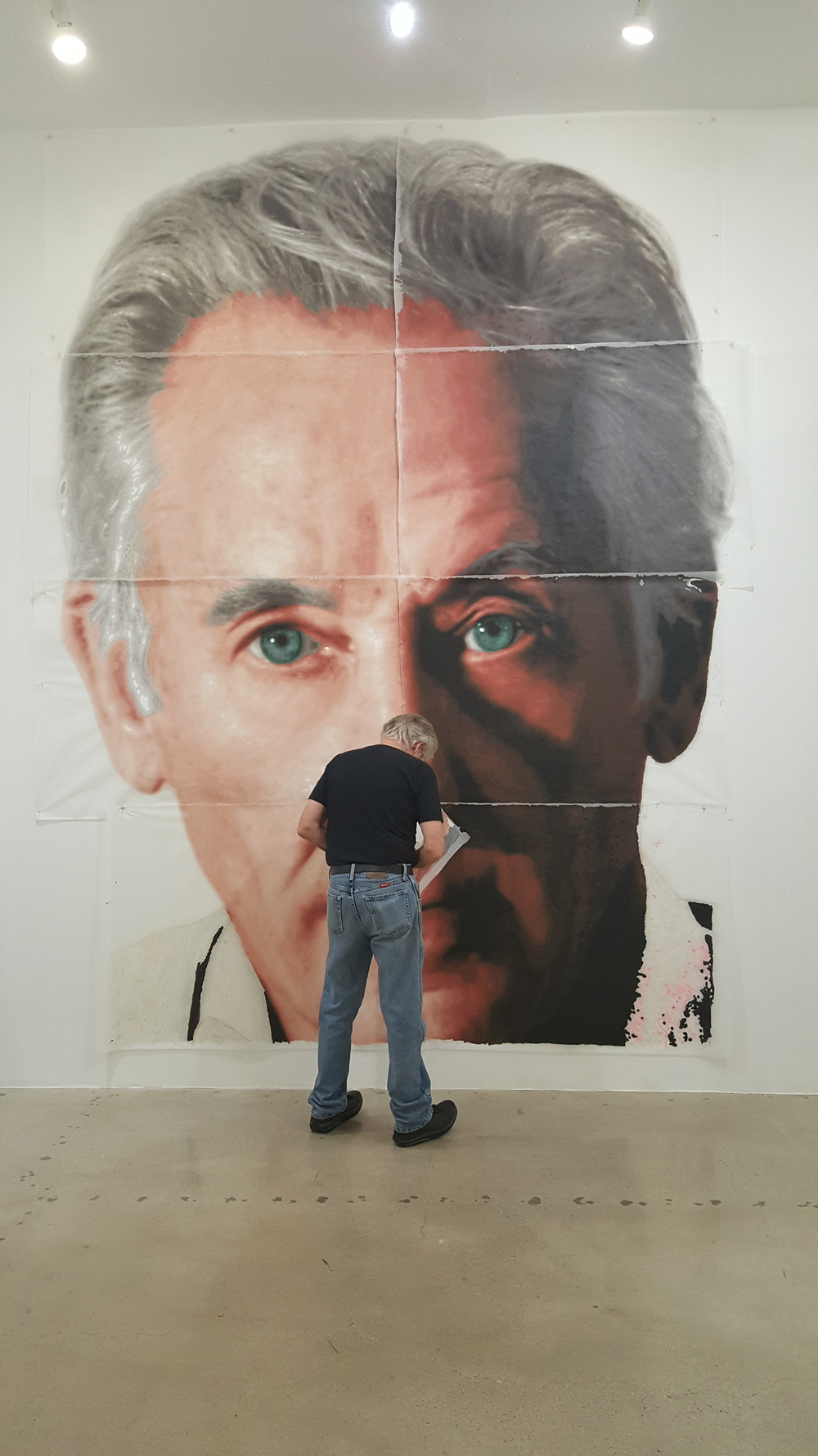 Kent completing the face of the mural