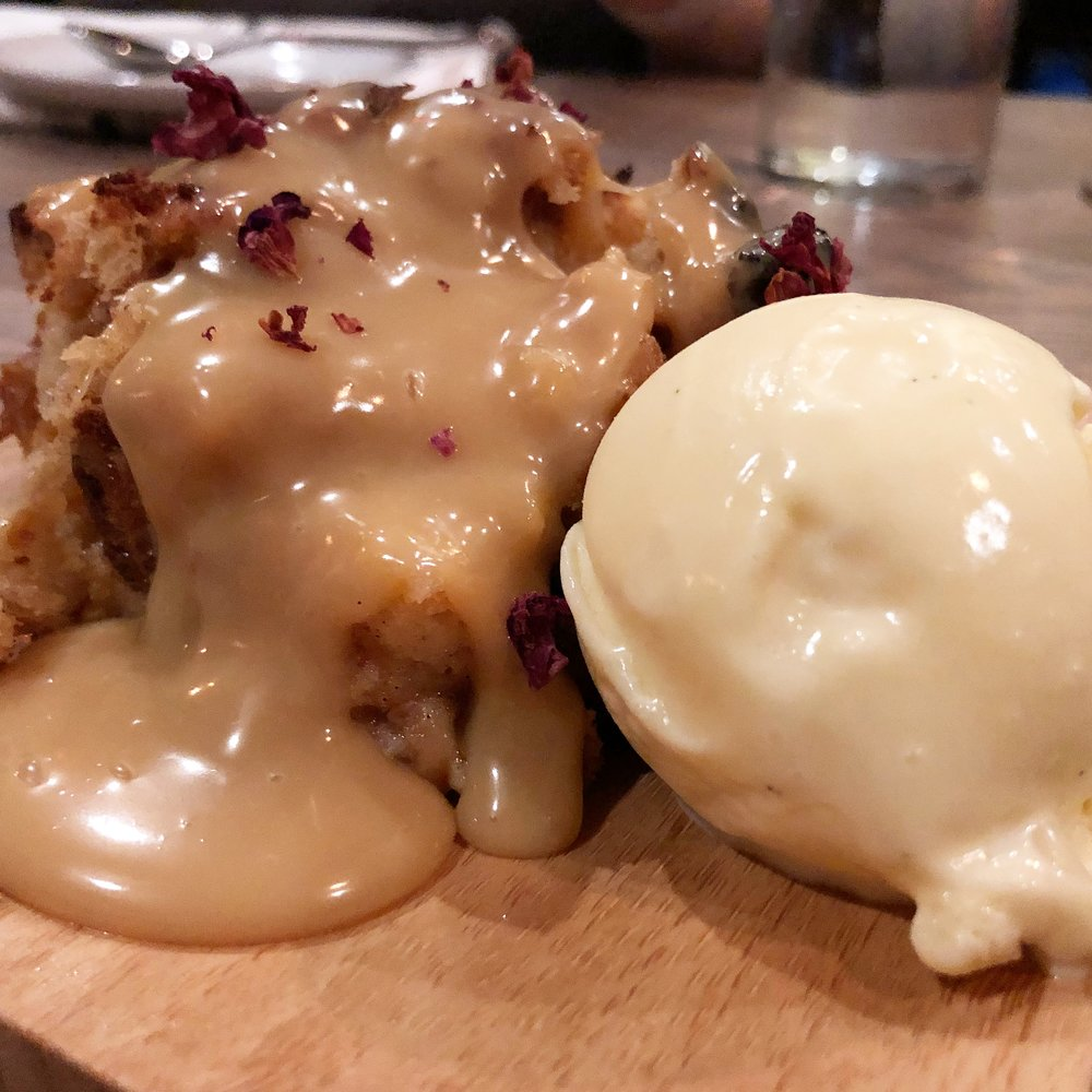 Krispy Kreme bread pudding - with dulce de leche, vanilla-yuzu ice cream and candied rose petals