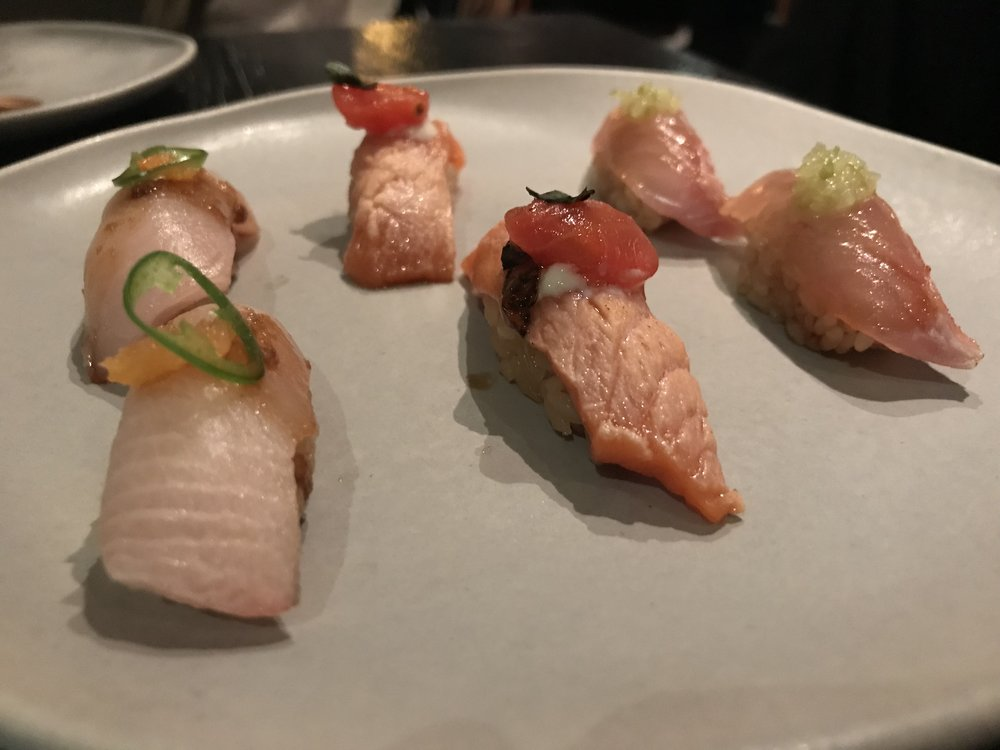 Assorted Nigiri - Closest: Yellowtail, middle: New Zealand King Salmon with tomato confit and whipped tofu, back: Golden Eye Snapper