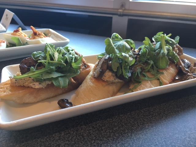 Wild Mushroom & Cheese Crostini - Garlic crostini, three cheese spread, & wild mushrooms