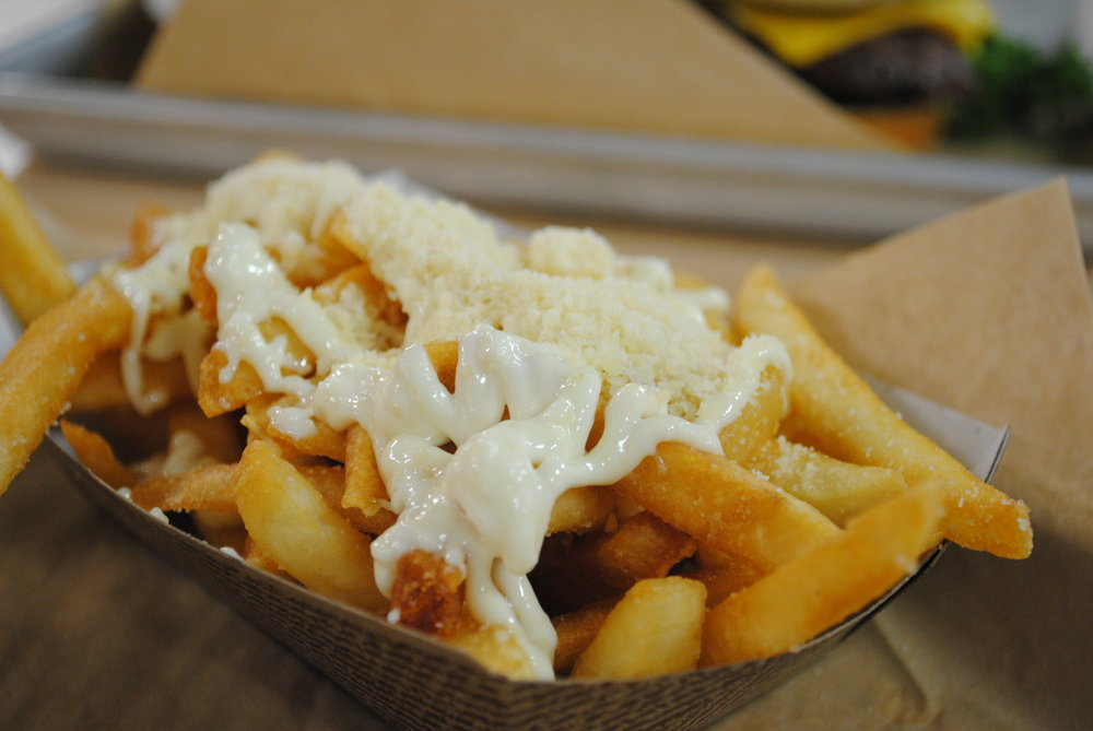 Truffle Fries - Classic french fries topped with a creamy white truffle sauce