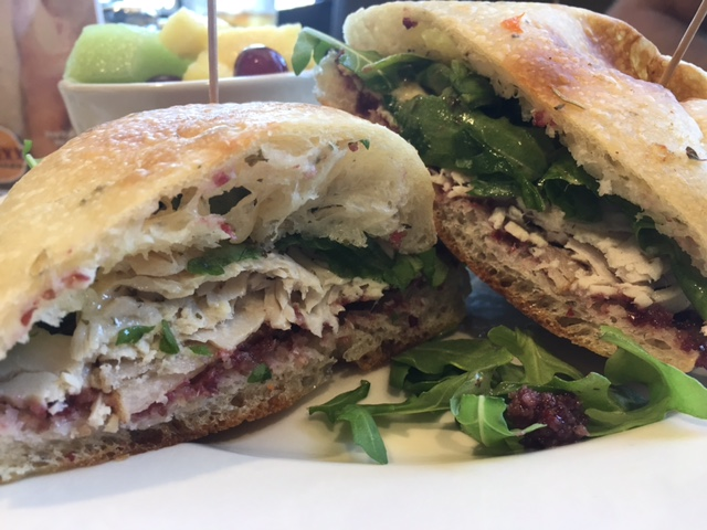 Turkey & Pecan-Cranberry Chutney - Thick carved turkey with sliced Asian pears and pecan cranberry chutney topped with honey-herb arugula on fresh-baked focaccia