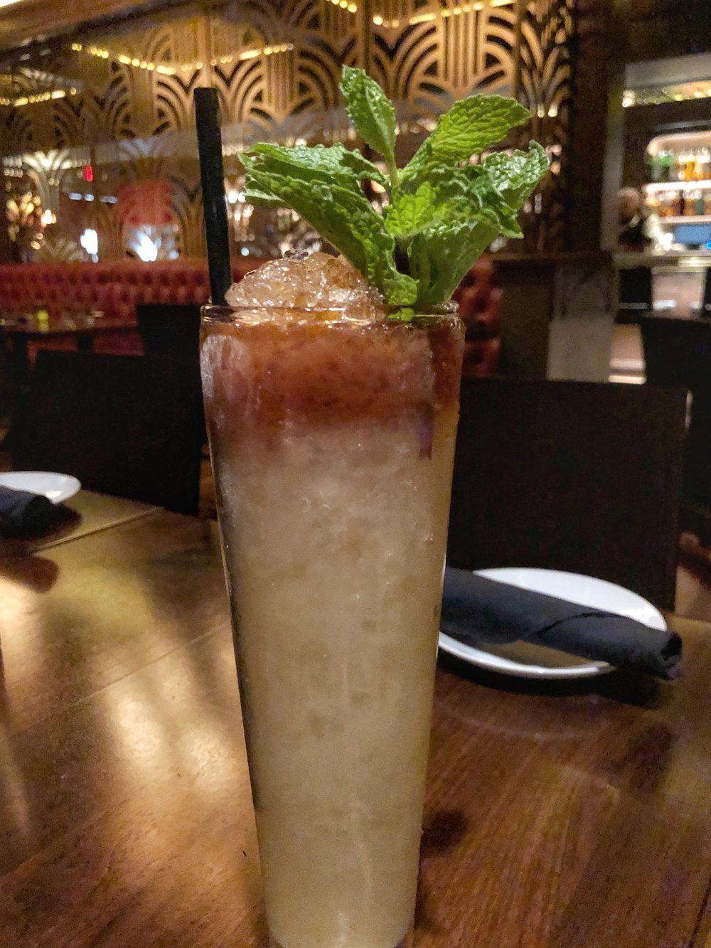 The Queen City Swizzle - Dragon Moonshine rum, green chartreuse, mint, sugar, angostura bitters, served over crushed ice