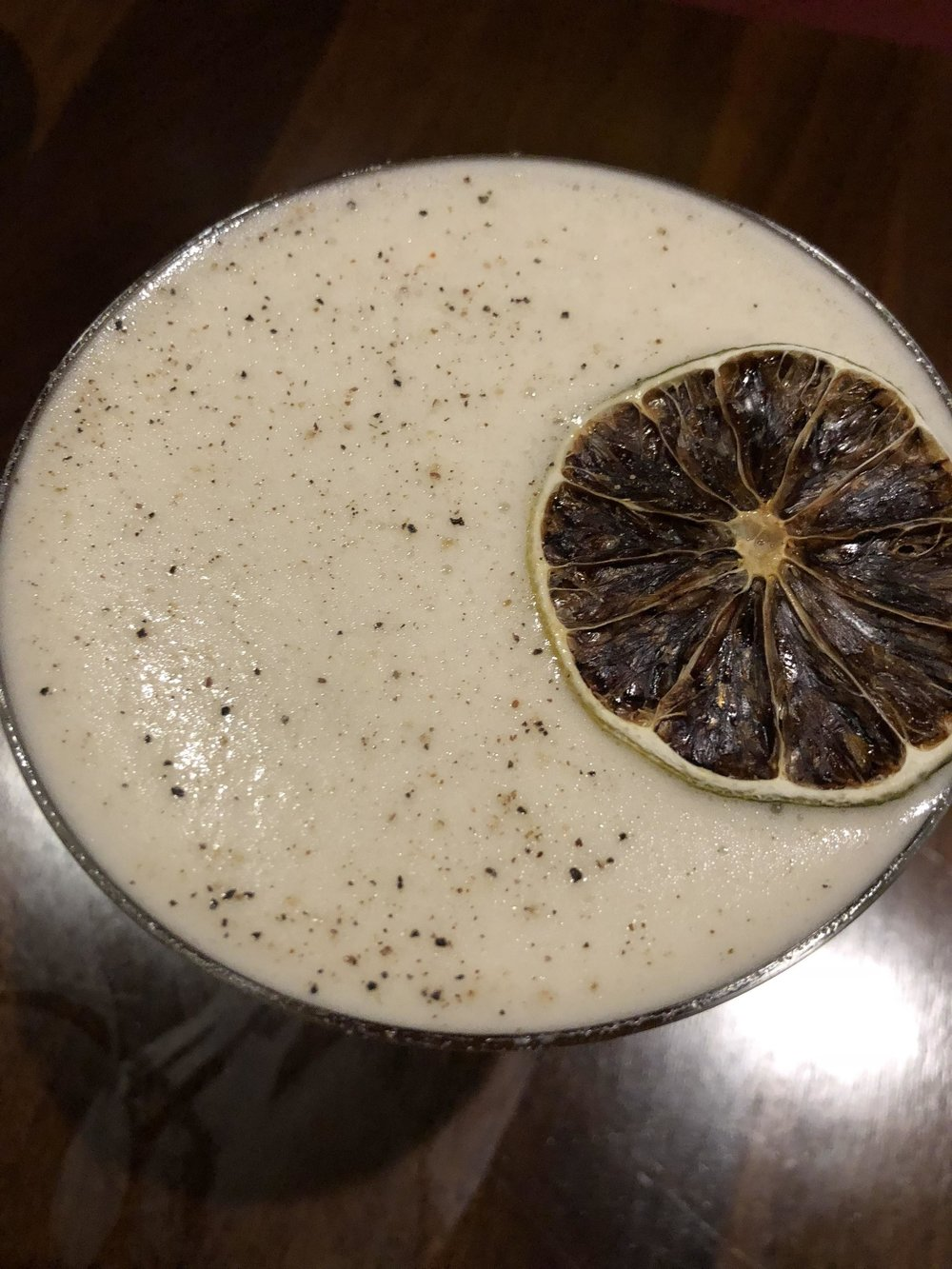 Pepper le Pew - Lunazul Primero tequila, black peppercorn-honey syrup, lime juice, cardamaro, egg white, served up