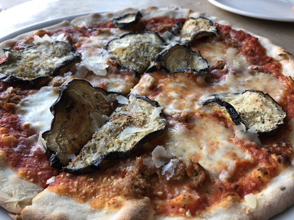 Parmigiana - tomato sauce, homemade Italian sausage, fior di latte (fresh mozzarella), roasted eggplant, shaved parmigiano reggiano