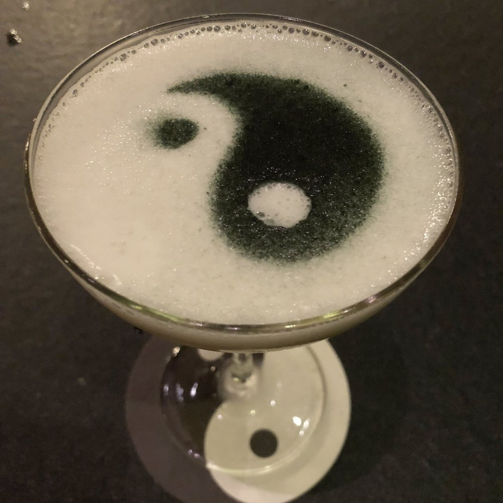 Prosperity - vodka, lotus, lemongrass, passion fruit, egg whiteMister Jiu's signature cocktail. How cool is that ying yang design? This baby was smooth and refreshing.