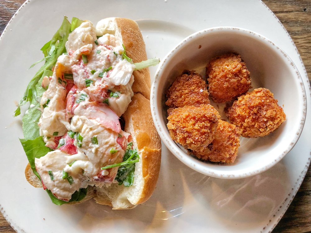 Maine Style Lobster Roll  - lobster lightly coated in mayo, greens