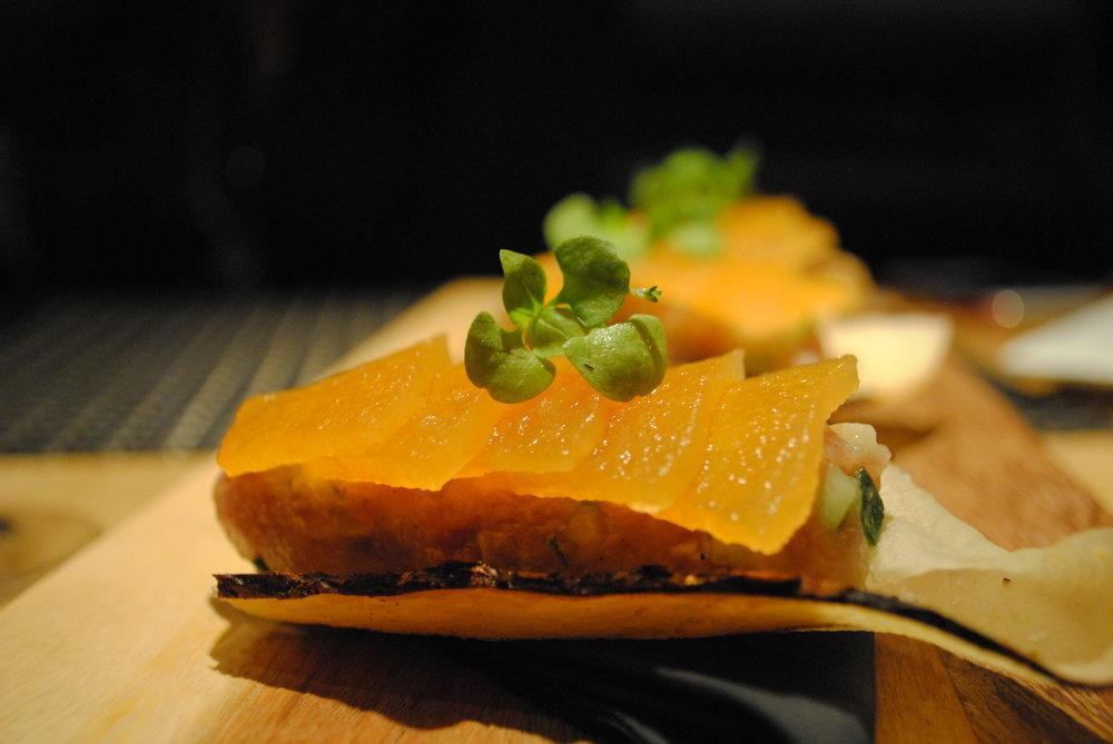 Ahi Tuna Crudo - yucca crisp, cucumber, compressed cantelope