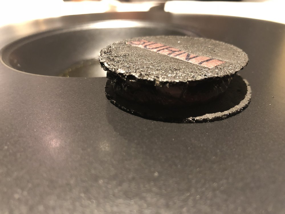 Burnt - This striking dish was a cuttlefish cracker that you dip in a squid ink sauce. This dish was meant to represent sometimes the best parts of food, the burnt edges, ends, and other dodgy parts of food. Was it cheesy to have