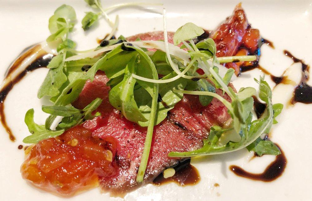Beef Carpaccio - tomato jam, parmigiana gel, arugula