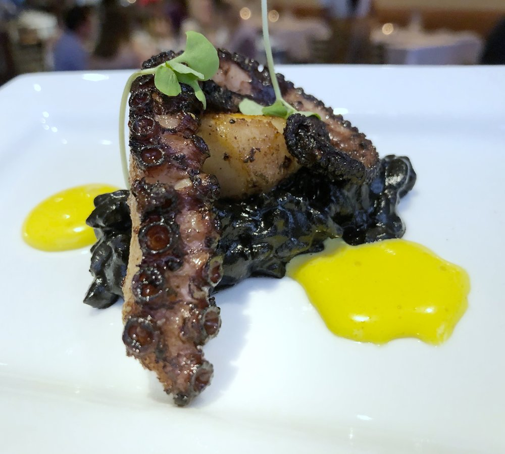 Roasted OCTOPUS - black risotto, saffron emulsionPerfectly cooked.