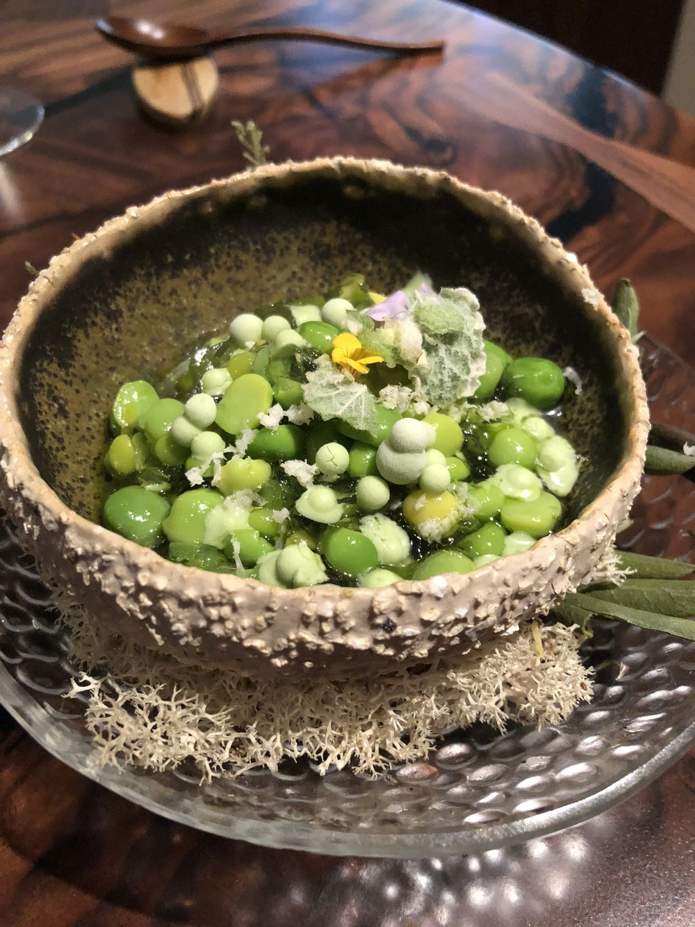 From the wintry mist, tender specks on the meadow begin to stir - English Pea & MintOne of our favorite dishes. Early spring peas were mixed with beads of frozen crème fraîche. Tableside, ham broth was stirred in. This was spring in a bowl—the flavors were bursting with freshness and the mix of crunchy textures made every bite a revelation.