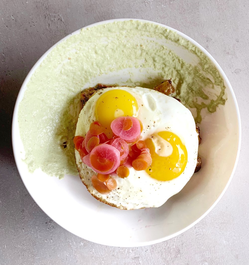 Southern Shorty - Short rib hash, winter green pesto, fried eggs, carrot chow chow