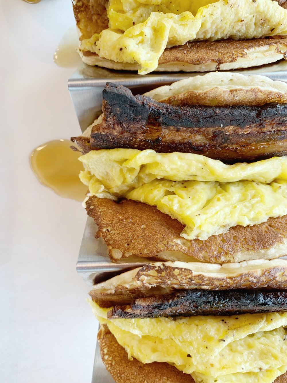 Pancake Tacos - Fluffy pancakes filled with house bacon and scrambled eggs with spiced maple syrup to dipPancake. Tacos. Is there anything else to say?