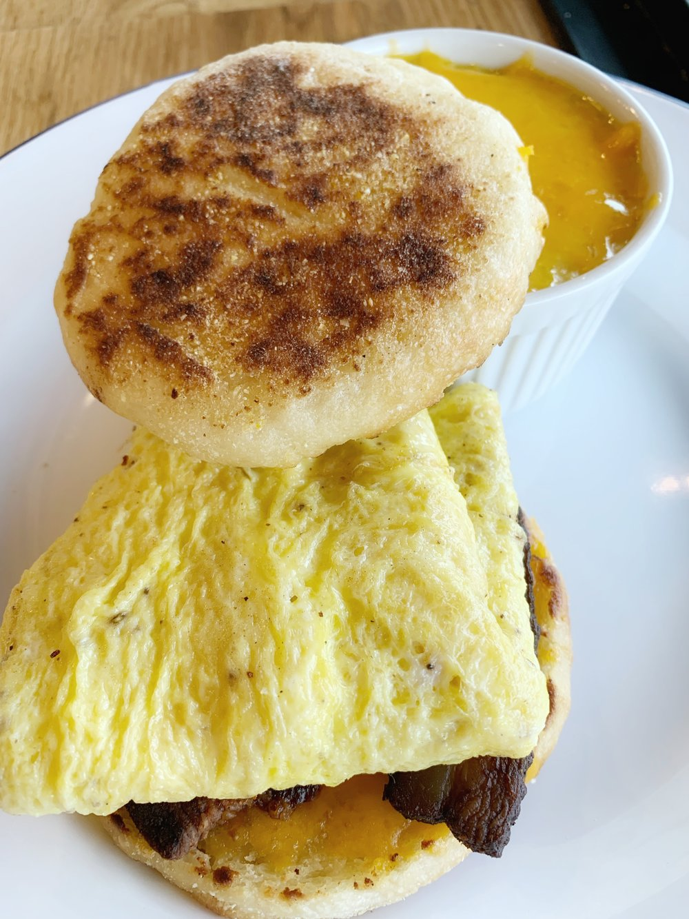 Andrew's Breakfast Sandwich - House English muffin, omelet with Ashe county sharp cheddar and choice of house bacon, sausage, or tempeh sausageHouse-made English muffins are the stuff of life.