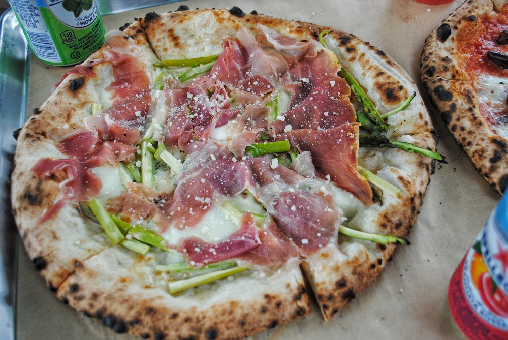 Pizza Di Parma - Imported prosciutto, roasted asparagus, Buffalo Mozzarella, garlic, sea salt, & Pecorino
