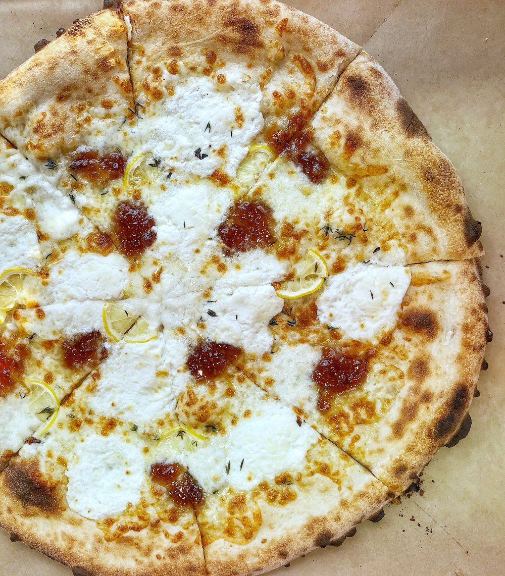 Limone Capra - Thinly sliced lemons, fig jam, goat cheese ricotta, Buffalo Mozzarella, & fresh thyme