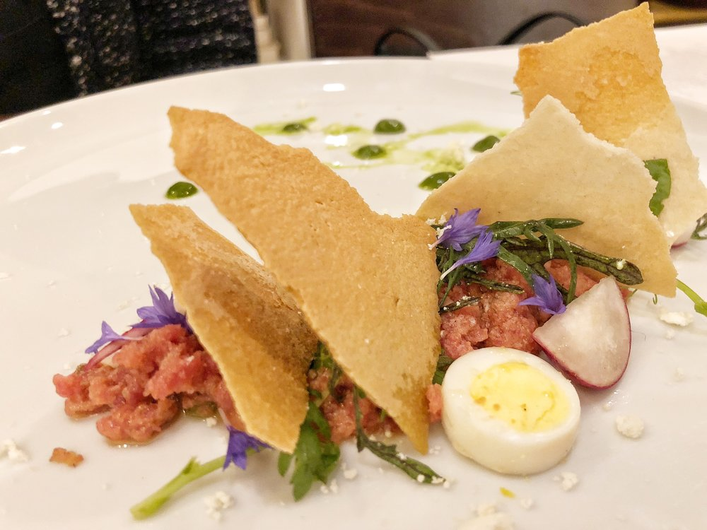 Beef Tartare - Radishes, greens, egg, capers, and flat breadCan you ever go wrong with tartare? They let the flavor of the meat shine through with simple seasoning and accoutrements. A+.