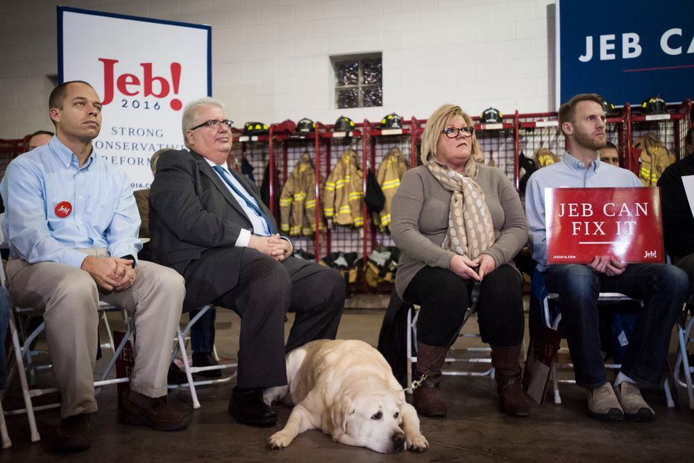 Supporters look on as U.S. Republican presidential candidate Jeb Bush hosts a town hall at the Waukee Fire Department in Waukee, IA November 11, 2015.