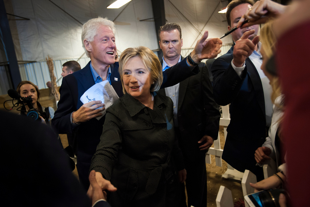 Former U.S. President Bill Clinton and Democratic U.S. presidential candidate Hillary Clinton greet supporters after a speech at the Central Iowa Democrats Fall Barbecue in Ames, Iowa.