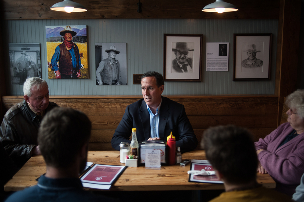U.S. Republican presidential candidate Rick Santorum meets with supporters at Northside Diner in Winterset, Iowa December 8, 2015.