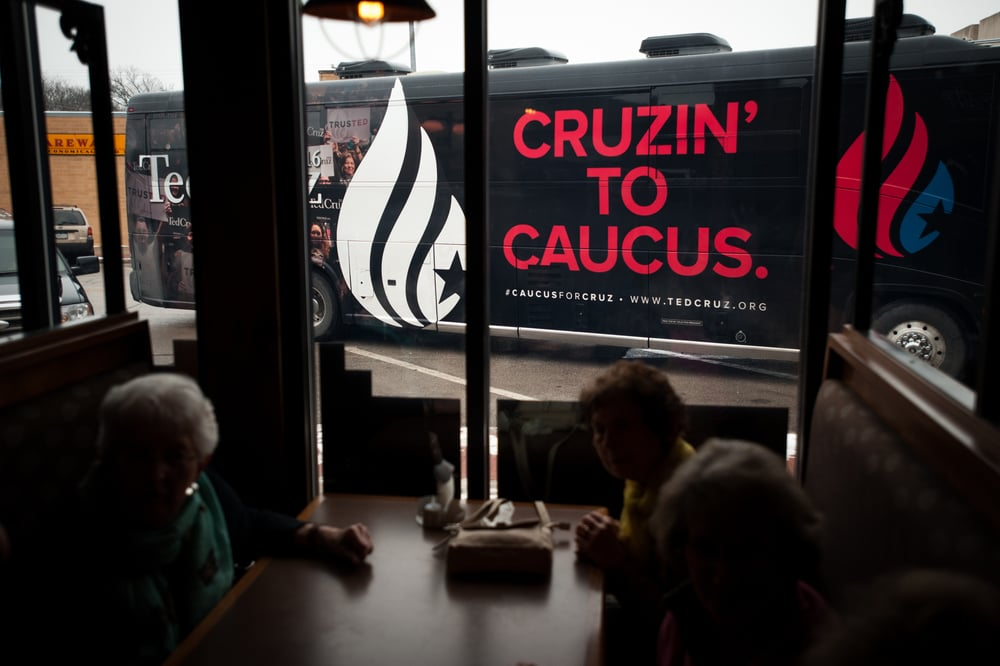 Women sit in a booth as the campaign bus for U.S. Republican presidential candidate Ted Cruz arrives at Rustix Restaurant and Event Center in Humboldt, Iowa January 7, 2016.