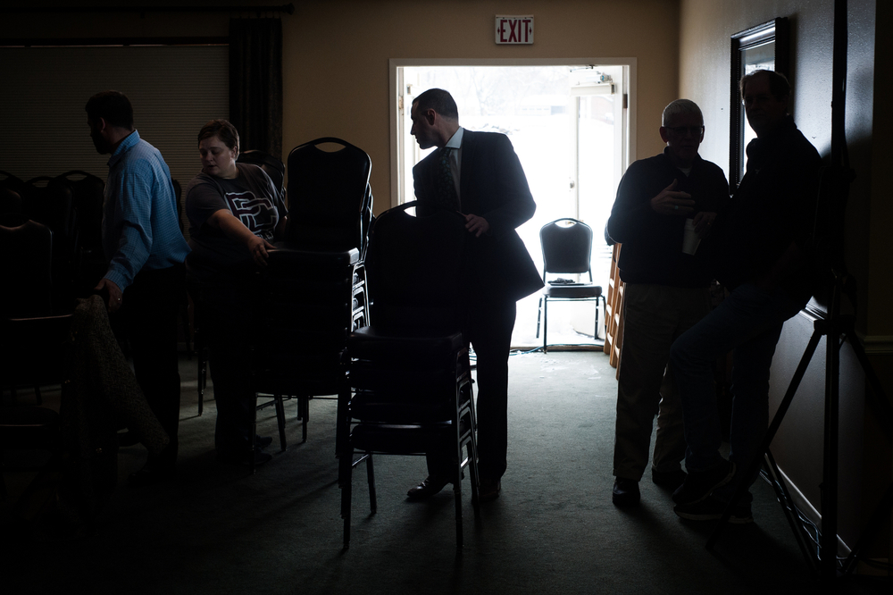 Staff, volunteers, and attendees stack chairs and clean up after Republican U.S. presidential candidate Marco Rubio's town hall event in Pella, Iowa on December 30, 2015.