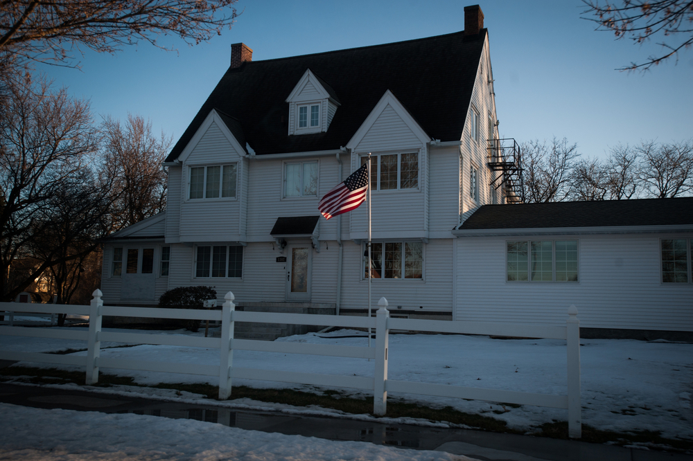 A flag waves in the wind outside a house down the street from where Democratic U.S. presidential candidate Bernie Sanders was scheduled to speak in Marshalltown, Iowa on January 31, 2016.